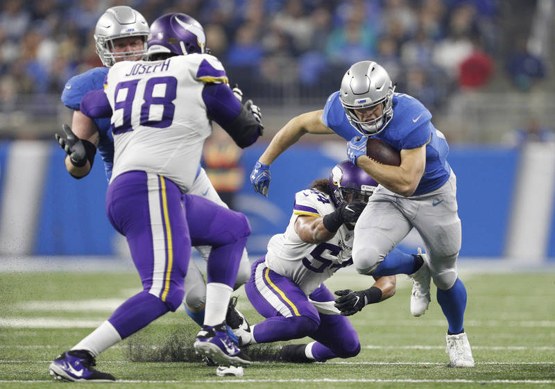 Nov 23, 2017; Detroit, MI, USA; Detroit Lions running back Zach Zenner (34) runs the ball against Minnesota Vikings middle linebacker Eric Kendricks (54) and defensive tackle Linval Joseph (98) du ...