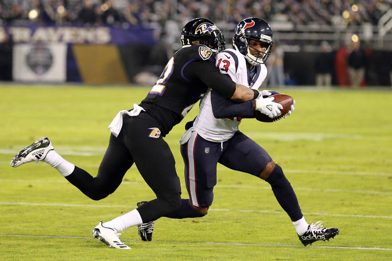 Nov 27, 2017; Baltimore, MD, USA; Baltimore Ravens cornerback Jimmy Smith (22) tackles Houston Texans wide receiver Braxton Miller (13) following his catch at M&T Bank Stadium. Mandatory Credi ...