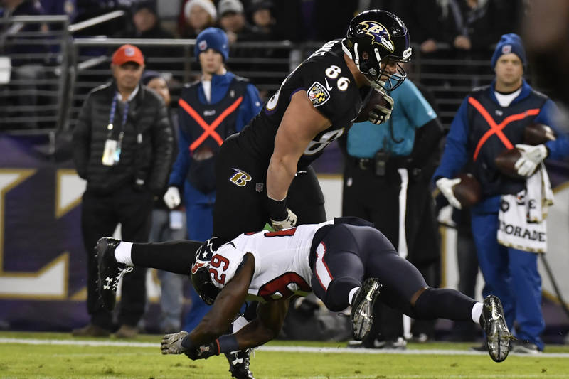 Nov 27, 2017; Baltimore, MD, USA; Baltimore Ravens tight end Nick Boyle (86) runs as Houston Texans safety Andre Hal (29) tackles during the second quarter at M&T Bank Stadium. Baltimore Raven ...