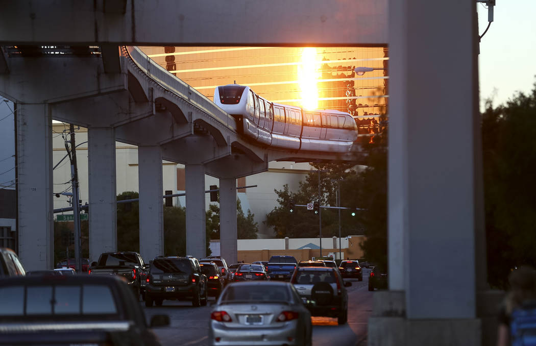 The Las Vegas Monorail turns onto Sand Avenue from S. Koval Lane on Thursday, Dec. 14, 2017. Richard Brian Las Vegas Review-Journal @vegasphotograph