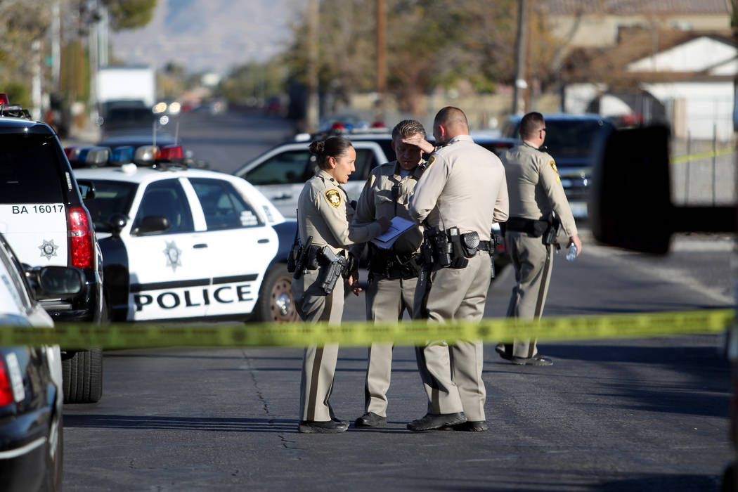 Las Vegas police investigate the scene at the corner of Holly Avenue and Allen Lane near Rancho and Vegas drives Friday, Dec. 1, 2017, where a male shooting victim was found in the street. K.M. Ca ...