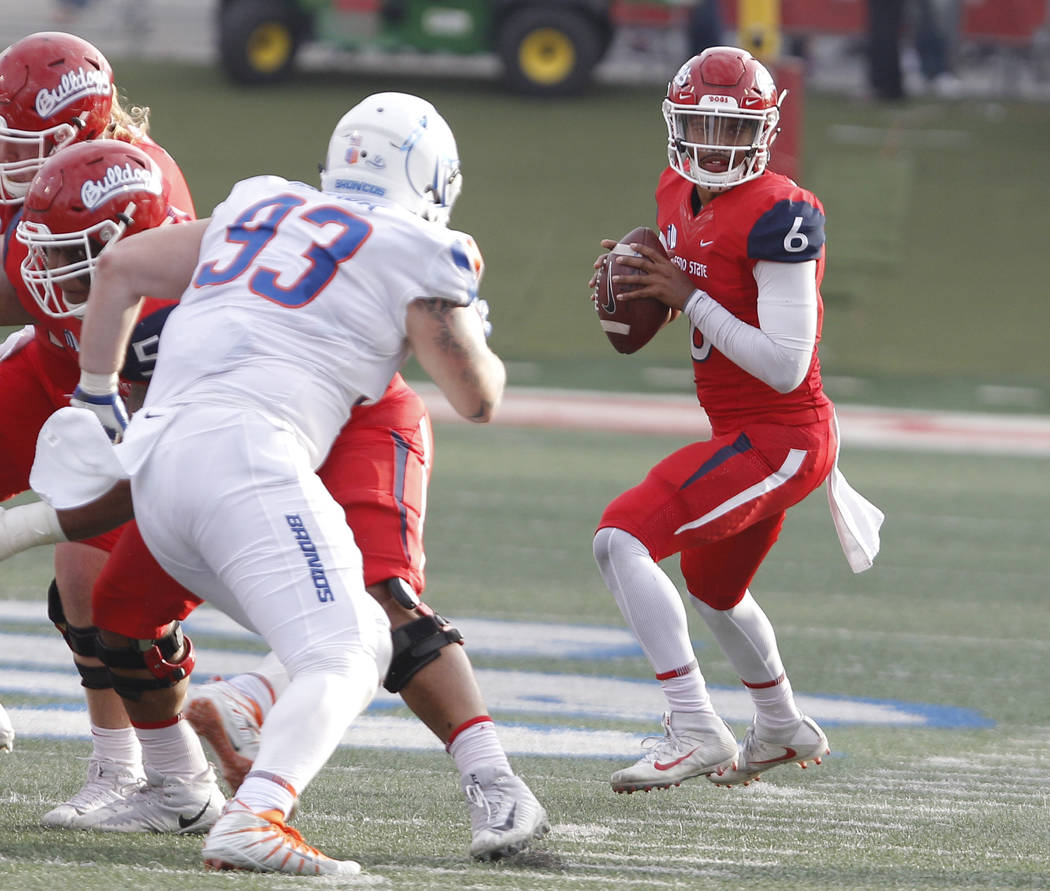 Fresno State's Marcus McMaryion drops back to pass against Boise State's Chase Hatada during the second half of an NCAA college football game in Fresno, Calif., Saturday, Nov. 25, 2017. Fresno Sta ...