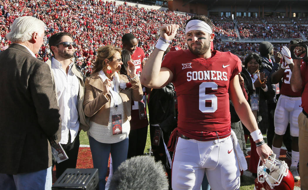 Oklahoma quarterback Baker Mayfield (6) during Senior Day before an NCAA college football game against West Virginia in Norman, Okla., Saturday, Nov. 25, 2017. (AP Photo/Sue Ogrocki)