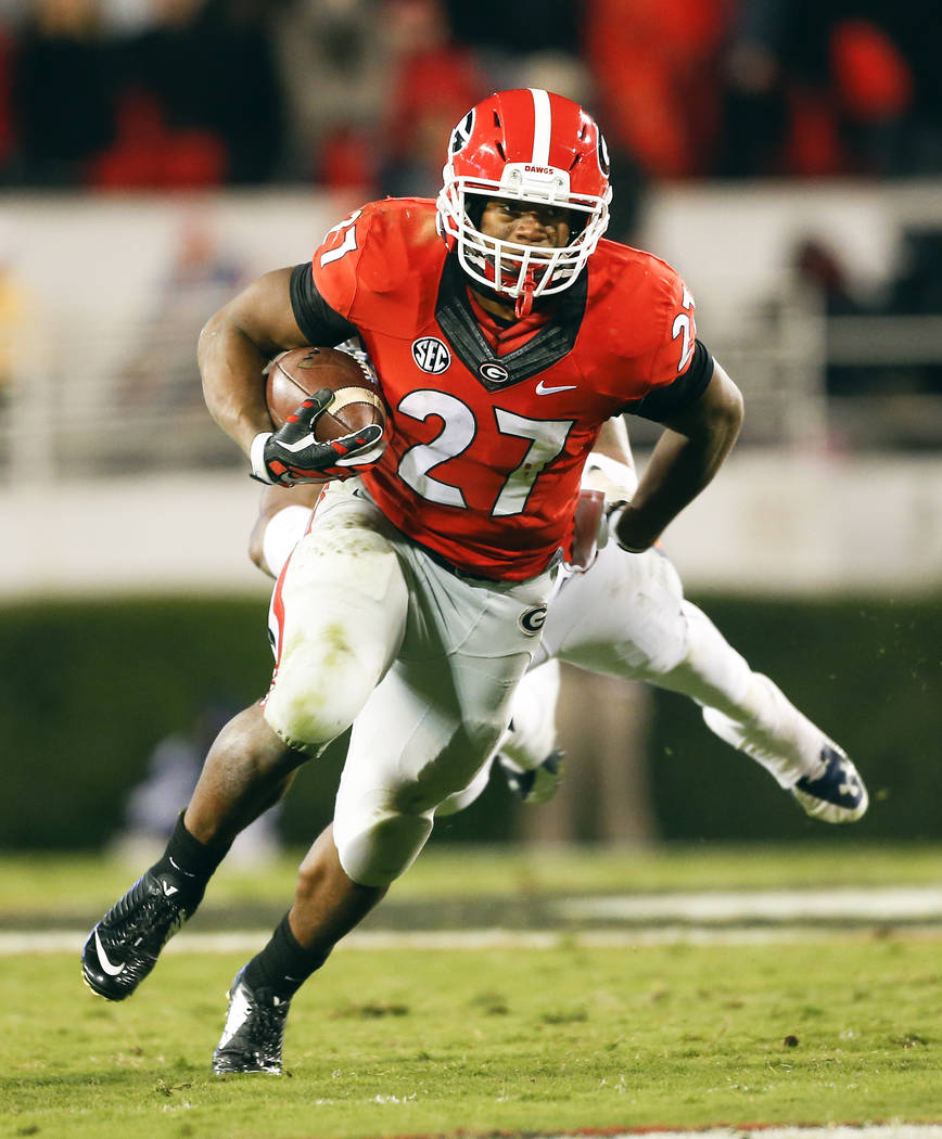 Georgia running back Nick Chubb (27) runs against Auburn  in the second half of an NCAA college football game Saturday, Nov. 15, 2014, in Athens, Ga. (AP Photo/John Bazemore)