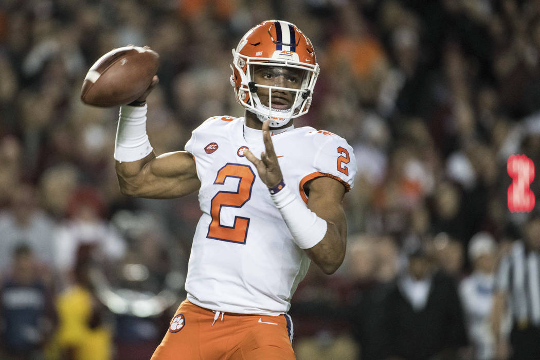Clemson quarterback Kelly Bryant (2) attempts a pass against South Carolina during the first half of an NCAA college football game on Saturday, Nov. 25, 2017, in Columbia, S.C. (AP Photo/Sean Rayford)