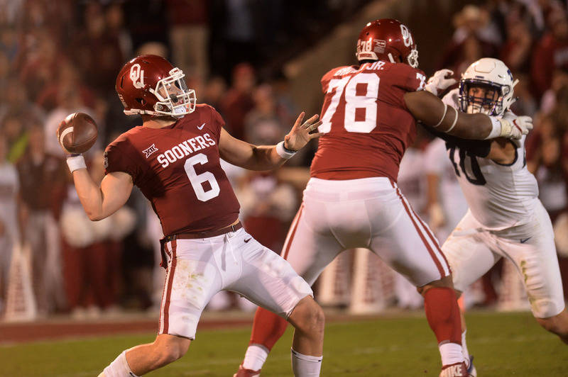 Nov 11, 2017; Norman, OK, USA; Oklahoma Sooners quarterback Baker Mayfield (6) passes the ball as offensive lineman Orlando Brown (78) blocks TCU Horned Frogs defensive end Michael Epley (40) duri ...
