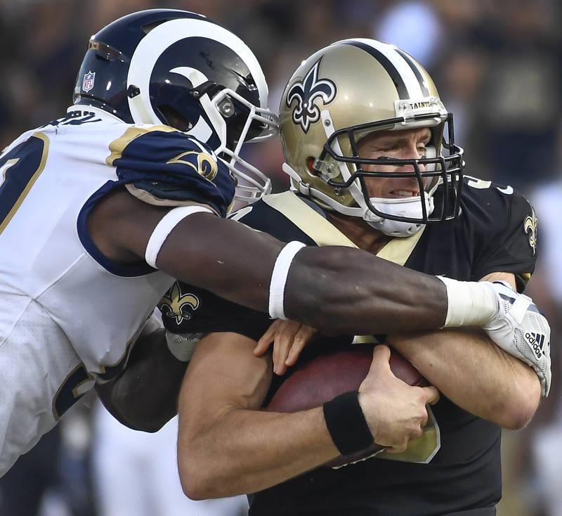 Nov 26, 2017; Los Angeles, CA, USA; Los Angeles Rams linebacker Samson Ebukam (50) sacks New Orleans Saints quarterback Drew Brees (9) in the third quarter at Los Angeles Memorial Coliseum. The Ra ...