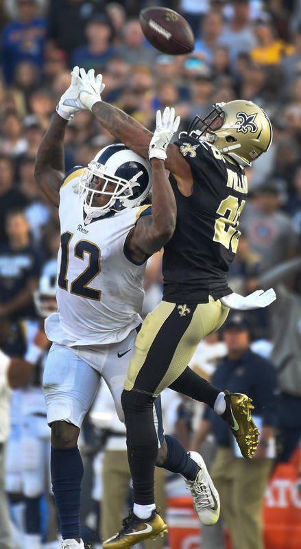Nov 26, 2017; Los Angeles, CA, USA; Los Angeles Rams wide receiver Sammy Watkins (12) and New Orleans Saints cornerback P.J. Williams (26) battle for a fourth quarter pass at Los Angeles Memorial  ...
