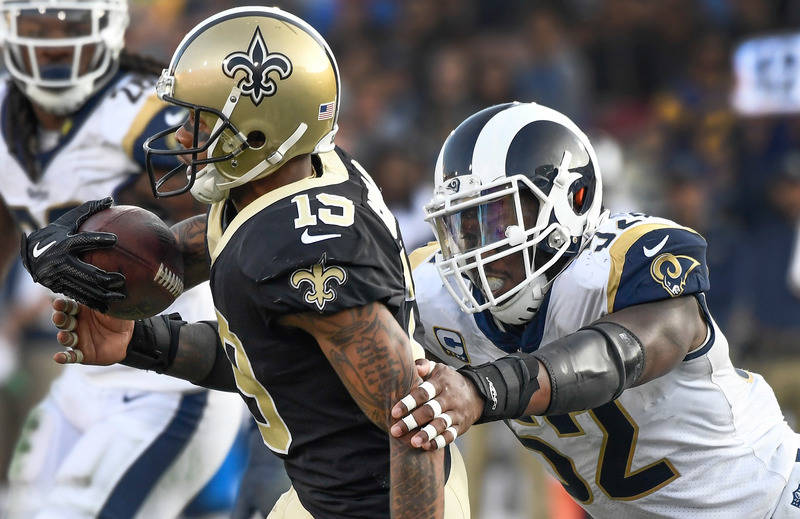 Nov 26, 2017; Los Angeles, CA, USA; Los Angeles Rams inside linebacker Alec Ogletree (52) grabs New Orleans Saints wide receiver Ted Ginn (19) during the third quarter at Los Angeles Memorial Coli ...