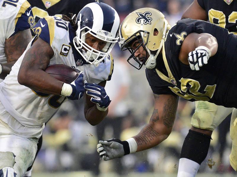 November 26, 2017; Los Angeles, CA, USA; Los Angeles Rams running back Todd Gurley (30) runs the ball against New Orleans Saints defensive tackle John Hughes (92) during the second half at the Los ...
