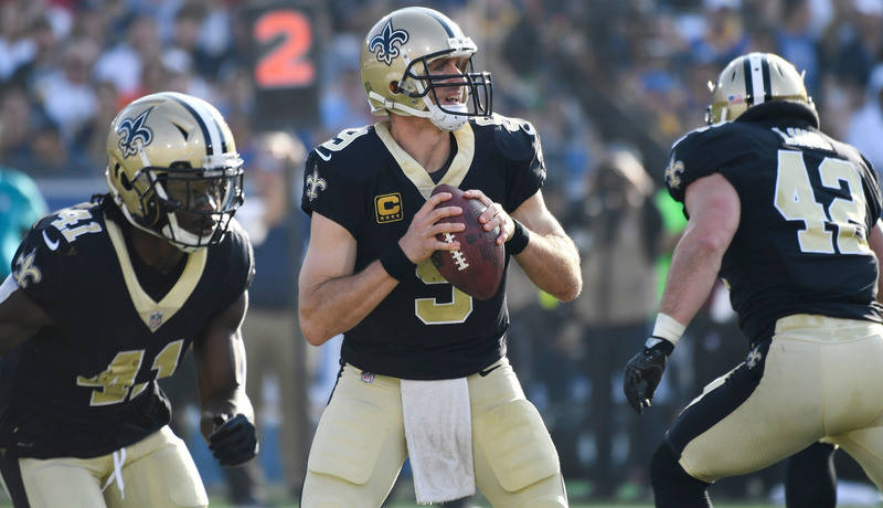 Nov 26, 2017; Los Angeles, CA, USA; New Orleans Saints quarterback Drew Brees (9) looks for an open receiver during the second quarter against the Los Angeles Rams at Los Angeles Memorial Coliseum ...