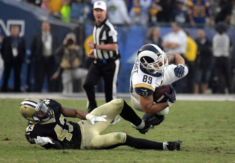 Nov 26, 2017; Los Angeles, CA, USA; Los Angeles Rams tight end Tyler Higbee (89) makes a catch in front of New Orleans Saints free safety Marcus Williams (43) in the fourth quarter during an NFL f ...