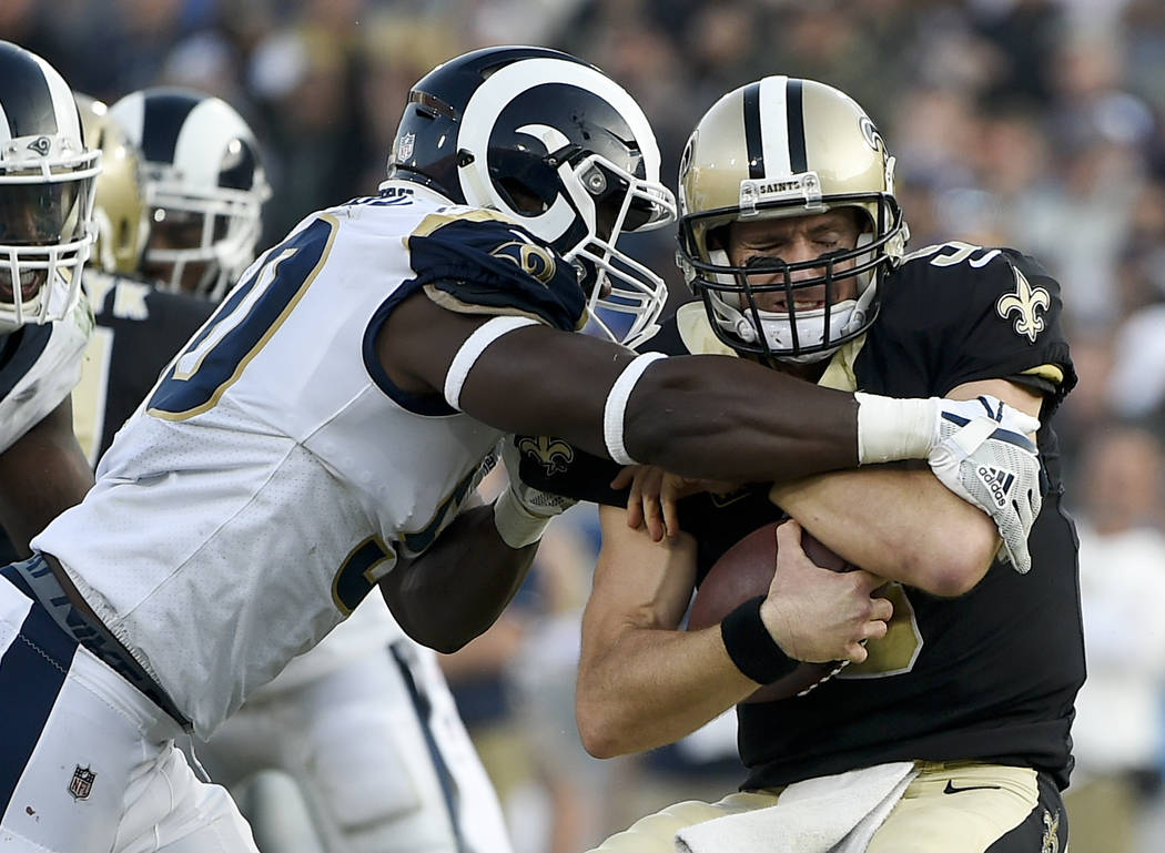 New Orleans Saints quarterback Drew Brees, right, is sacked by Los Angeles Rams linebacker Samson Ebukam during the second half of an NFL football game, Sunday, Nov. 26, 2017, in Los Angeles. (AP  ...