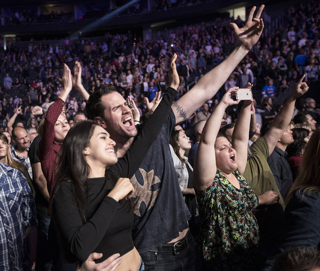 """Fans erupt as The Killers perform """"Mr. Brightside"""" during the Vegas Strong Benefit Concert at T-Mobile Arena on Friday, Dec. 1, 2017, in Las Vegas. Benjamin Hager Las Vegas Revie ..."""