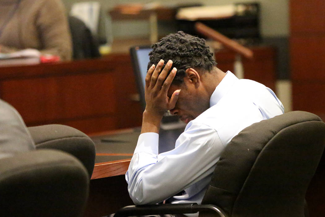 Bryan Clay, the Las Vegas man convicted of raping and murdering a mother and her 10-year-old daughter, is driven to tears as his mother, Latasha White, testifies during the penaltyphase of h ...
