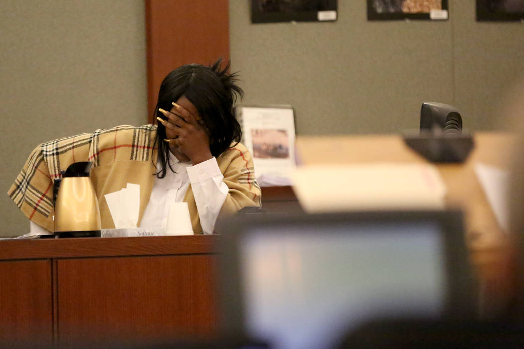 Latasha White, the mother of Bryan Clay, the Las Vegas man convicted of raping and murdering a mother and her 10-year-old daughter, breaks down as she looks through pictures presented by the defen ...