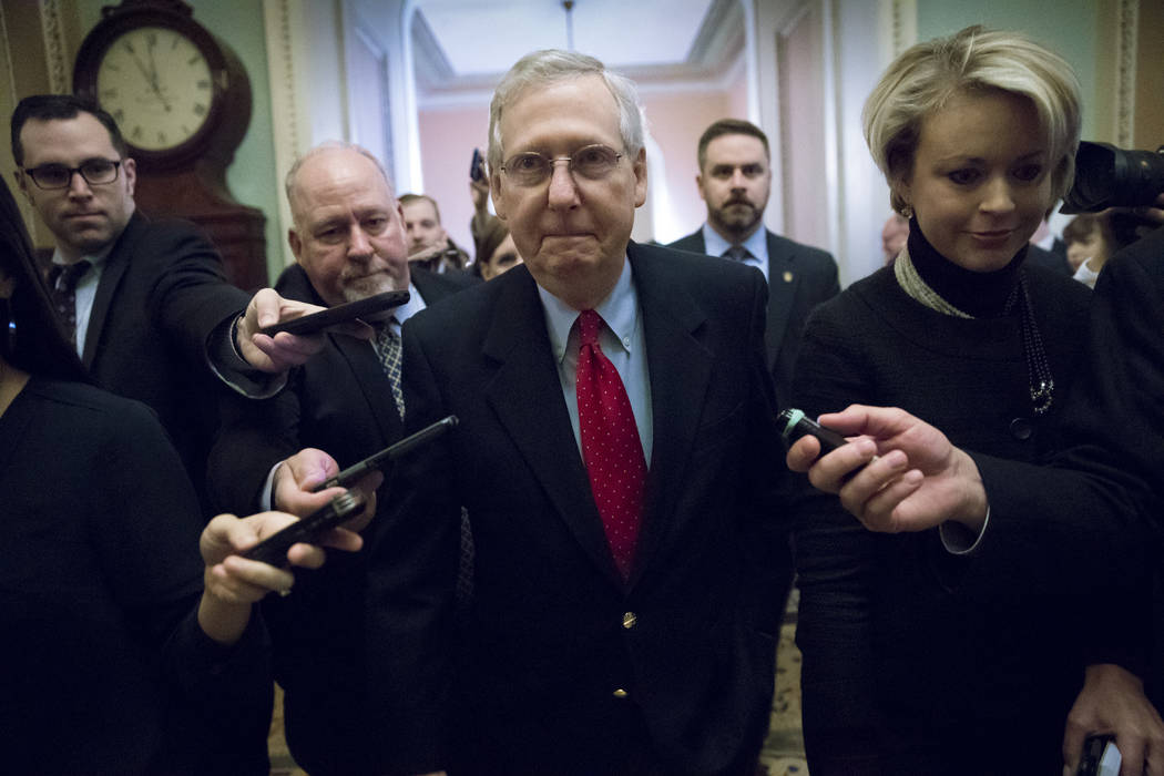 """Telling reporters """"we have the votes,"""" Senate Majority Leader Mitch McConnell, R-Ky., walks to the chamber after a closed-door meeting with Republican lawmakers to advance the st ..."""