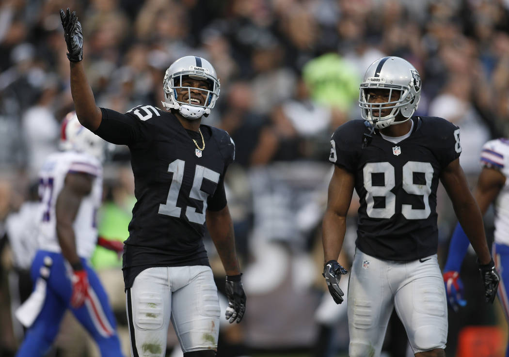 Oakland Raiders wide receiver Michael Crabtree (15) and wide receiver Amari Cooper (89) react during the second half of an NFL football game against the Buffalo Bills in Oakland, Calif., Sunday, D ...
