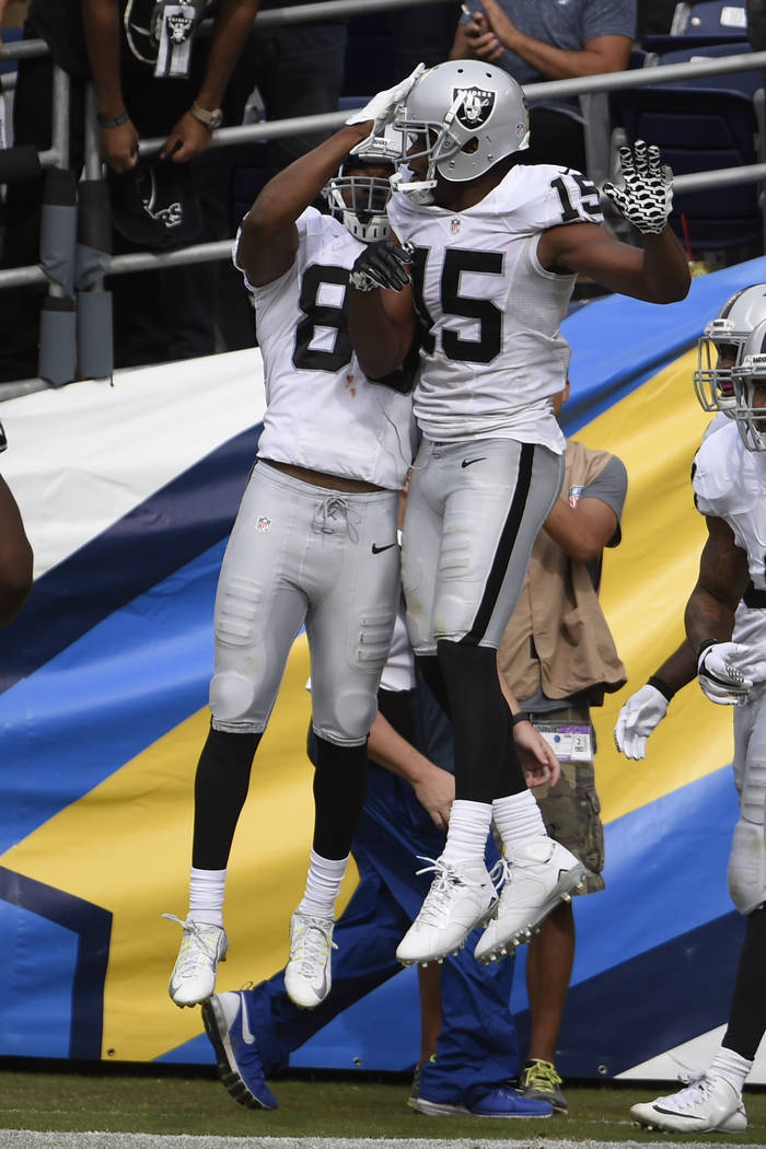 Oakland Raiders wide receiver Amari Cooper, left, celebrates his touchdown with teammate wide receiver Michael Crabtree during the first half of an NFL football game against the San Diego Chargers ...