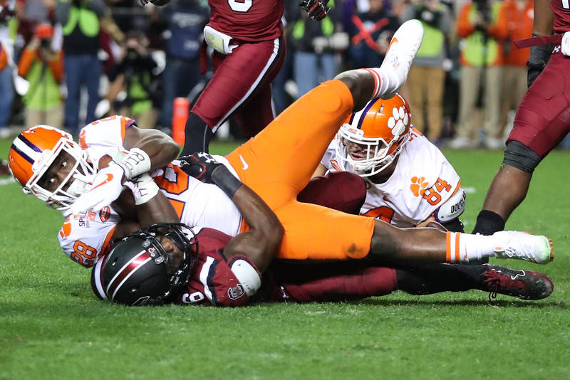 Nov 25, 2017; Columbia, SC, USA; Clemson Tigers running back Tavien Feaster (28) is tackled by South Carolina Gamecocks linebacker T.J. Brunson (6) during the first half at Williams-Brice Stadium. ...