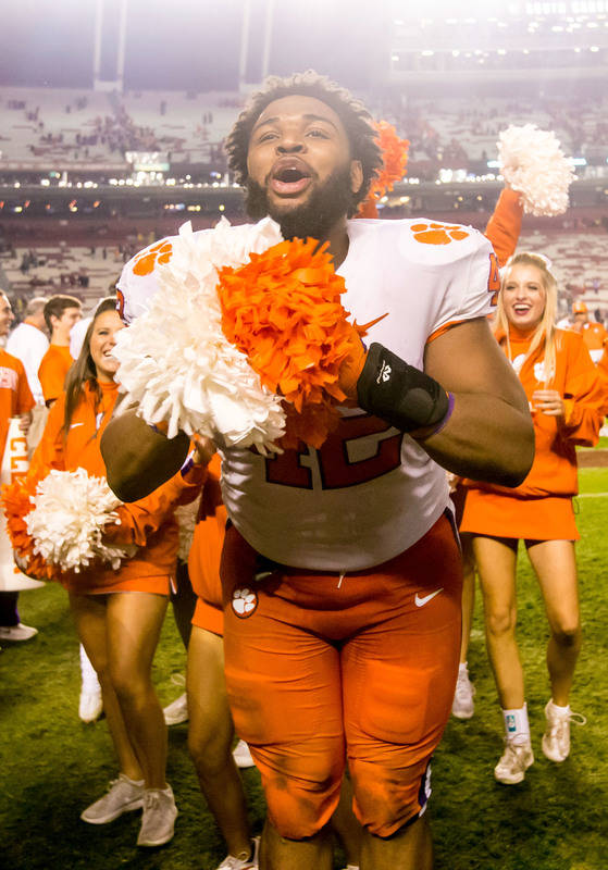 Nov 25, 2017; Columbia, SC, USA; Clemson Tigers defensive lineman Christian Wilkins (42) celebrates following their win over the South Carolina Gamecocks at Williams-Brice Stadium. Mandatory Credi ...