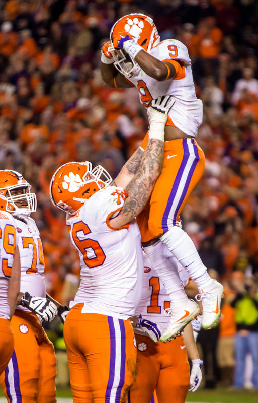 Nov 25, 2017; Columbia, SC, USA; Clemson Tigers offensive lineman Sean Pollard (76) and running back Travis Etienne (9) celebrate a touchdown by Etienne against the South Carolina Gamecocks in the ...