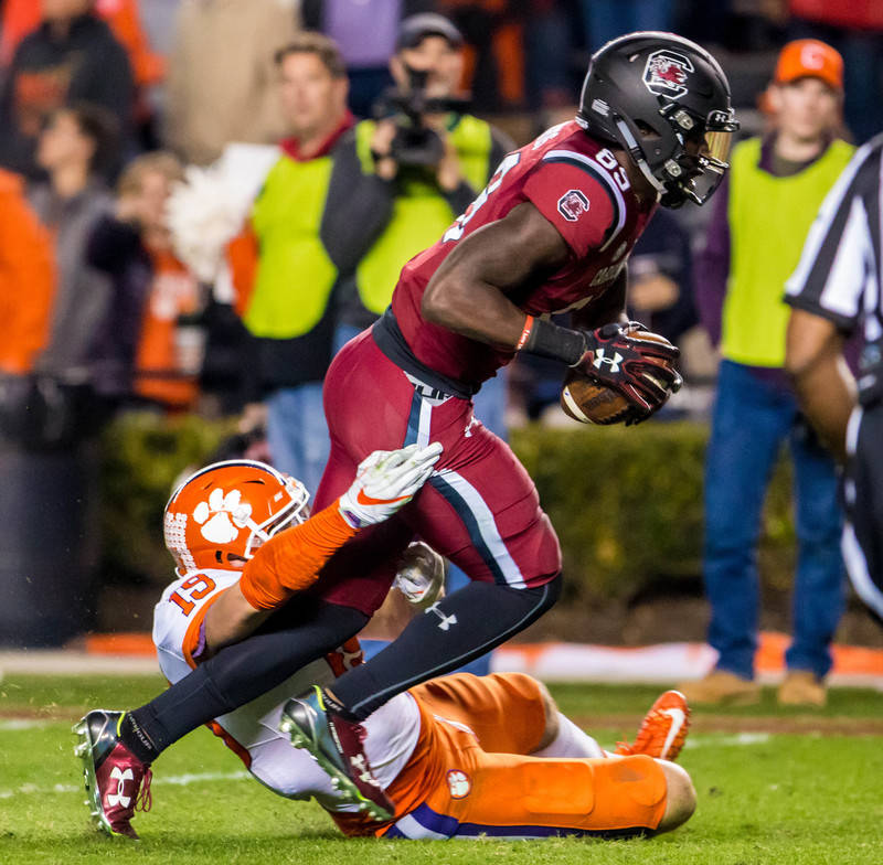 Nov 25, 2017; Columbia, SC, USA; South Carolina Gamecocks wide receiver Bryan Edwards (89) drags Clemson Tigers safety Tanner Muse (19) into the end zone for a touchdown in the second half at Will ...