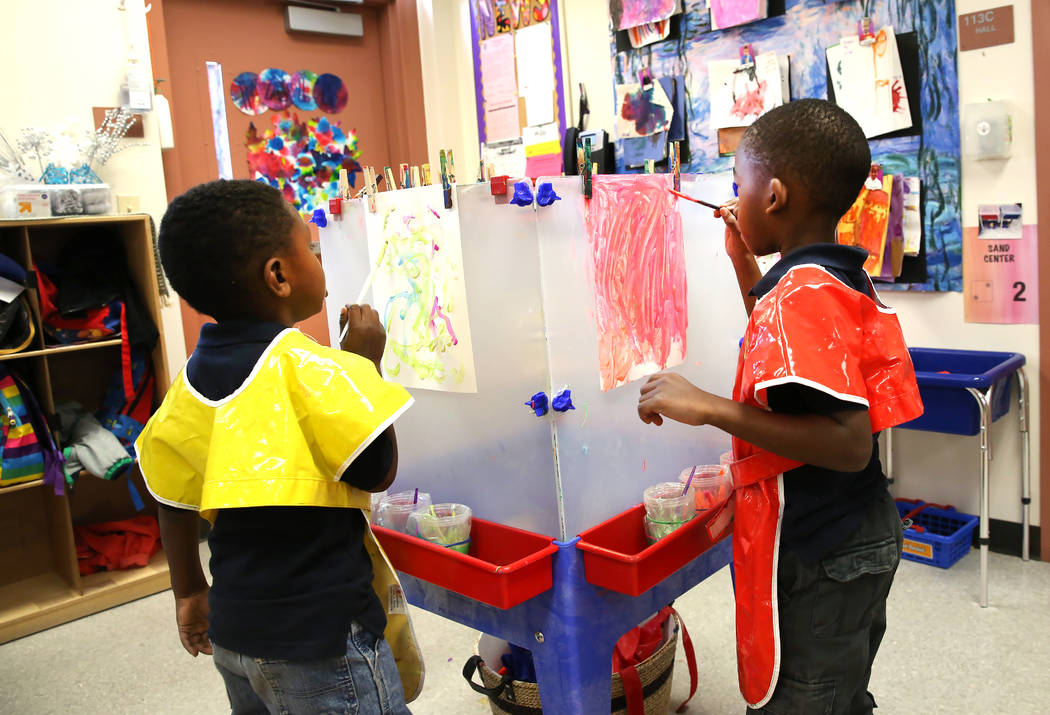 Pre-kindergarten students, Titus Mosley, 4, left, and Justin Davis, 4, paint inside their classroom at McCaw STEAM Academy on Monday, Dec. 4, 2017, in Henderson. (Bizuayehu Tesfaye/Las Vegas Revie ...