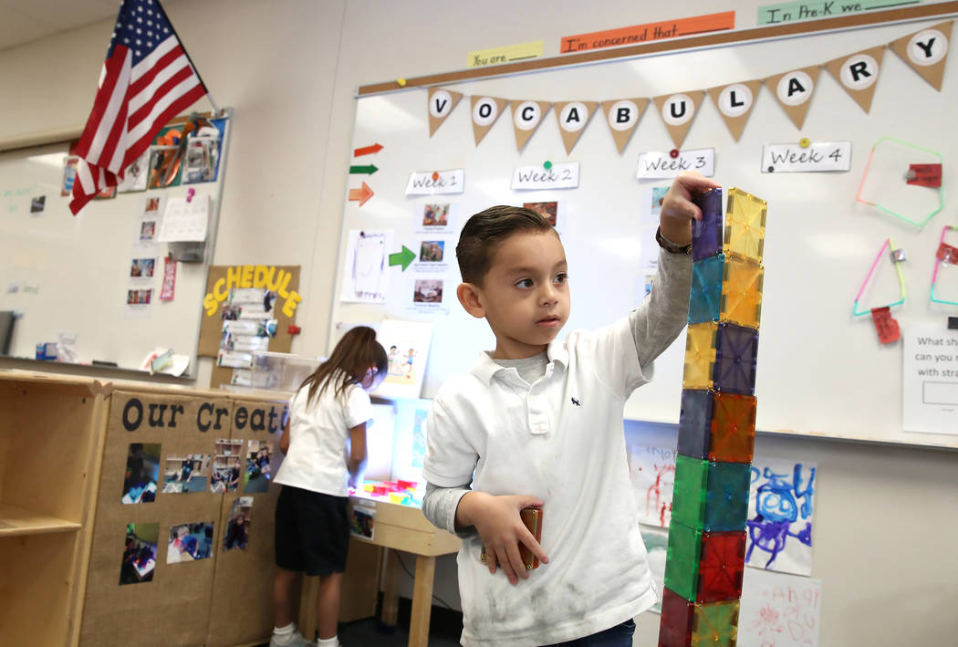 Pre-kindergarten student, Edward Cardenas Castro, 5, plays with magnetic tiles at McCaw STEAM Academy on Monday, Dec. 4, 2017, in Henderson. (Bizuayehu Tesfaye/Las Vegas Review-Journal)