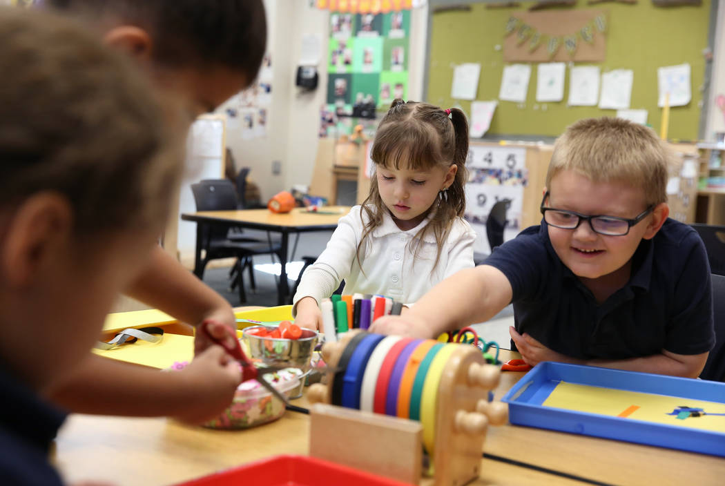 Pre-kindergarten students, including Tricoli Mackenzie, 4, center, and Paxton Wright, 5, right, work on their projects at McCaw STEAM Academy on Monday, Dec. 4, 2017, in Henderson. (Bizuayehu Tesf ...