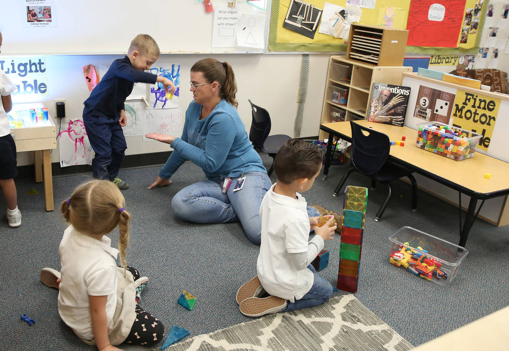 Specialized Programs Teaching Assistant, Heather Atkin, plays with pre-kindergarten students, including Nicolas Chirica, 4, left, at McCaw STEAM Academy on Monday, Dec. 4, 2017, in Henderson. (Biz ...