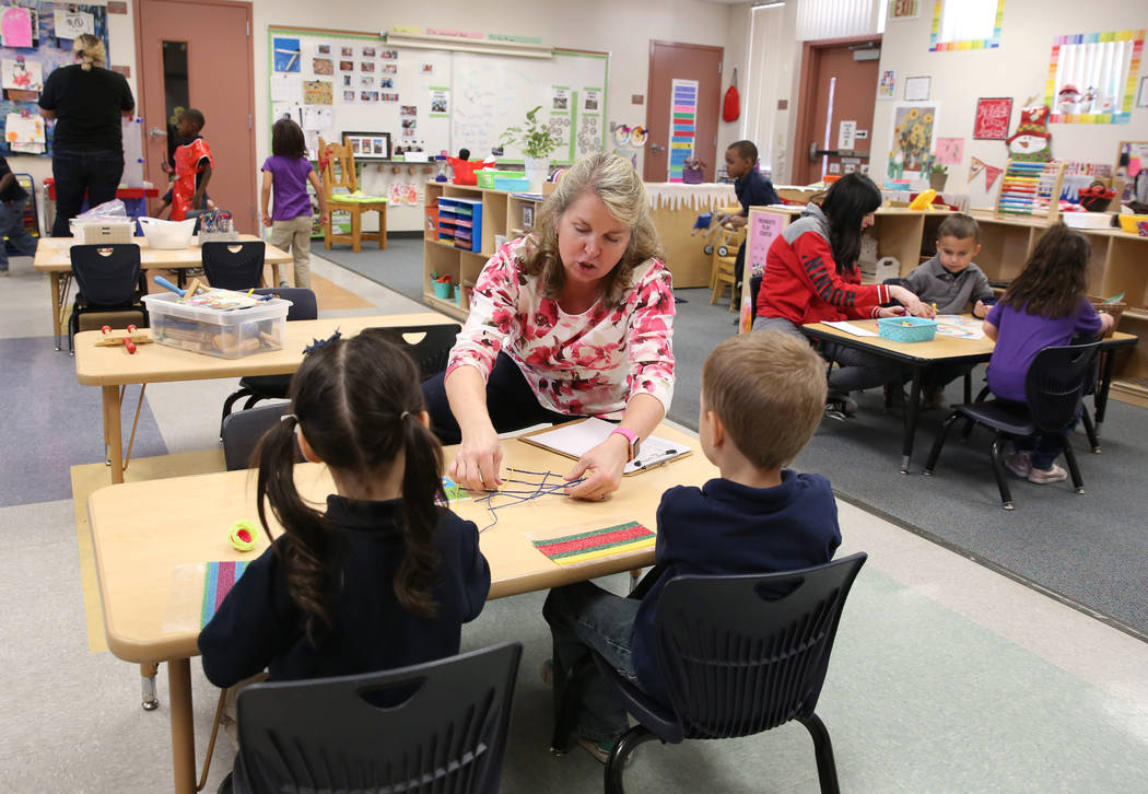 Pre-kindergarten teachers, Leslie Gallant, center, and Autumn Naegle, right, help students work on their projects at McCaw STEAM Academy on Monday, Dec. 4, 2017, in Henderson. (Bizuayehu Tesfaye/L ...