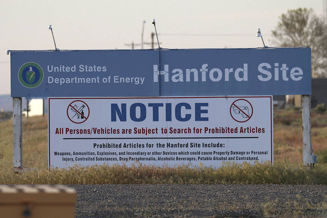 Signs are posted by the Hanford Nuclear Reservation in Richland, Wash., in May. (AP Photo/Manuel Valdes, File)