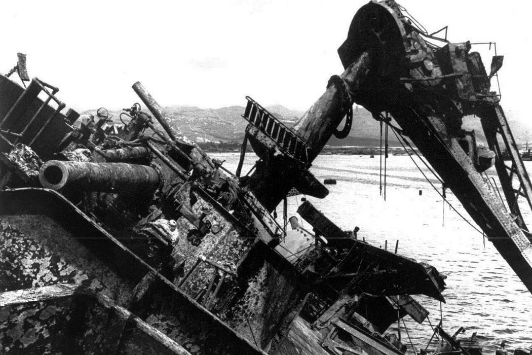 The capsized battleship USS Oklahoma is lifted out of the water at Pearl Harbor in Honolulu, Hawaii, in 1943.  (AP Photo, File)