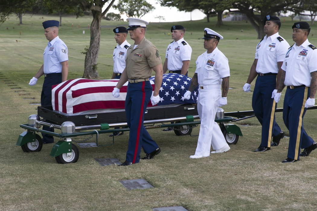 Military pallbearers, in 2015, escort the exhumed remains of unidentified crew members of the USS Oklahoma killed in the 1941 bombing of Pearl Harbor that were disinterred from a gravesite at the  ...