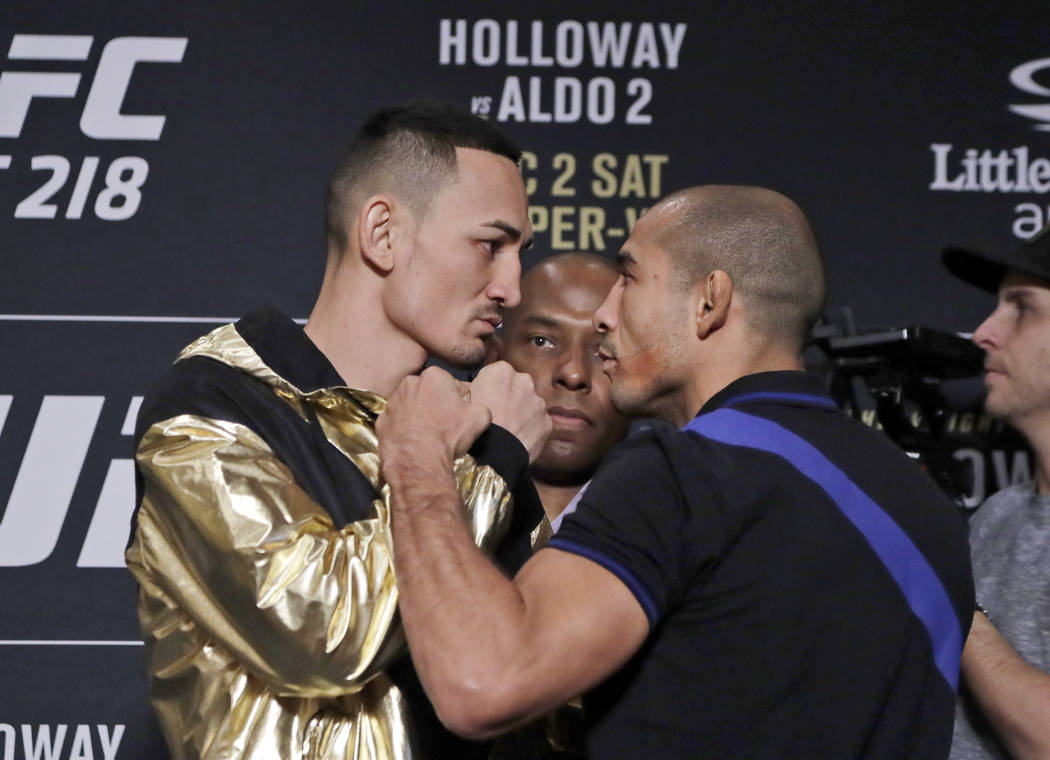 In a Thursday, Nov. 30, 2017 photo,  Max Holloway, left, faces Jose Aldo during media day for the UFC 218 mixed martial arts fight in Detroit. Holloway respects Aldo, saying he's one of the greate ...