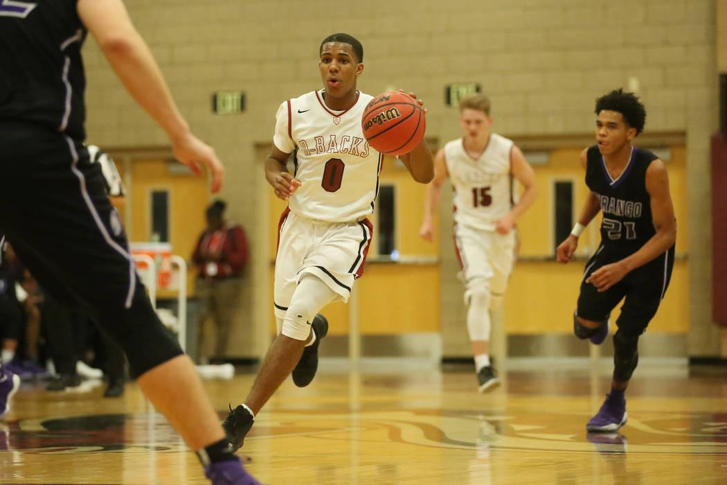 Desert Oasis player Kamari Burnside (0) brings the ball up the court during a game against Durango at Desert Oasis High School  in Las Vegas, Wednesday, Dec. 6, 2017.  Desert Oasis won 93-77. Brid ...