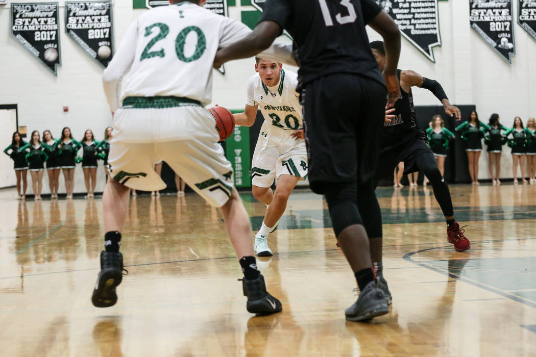 Palo Verde's Drew Warnick (30), center, dribbles the ball against Cimarron-Memorial during the second quarter of a basketball game at Palo Verde High School in Las Vegas, Thursday, Dec. 7,  ...