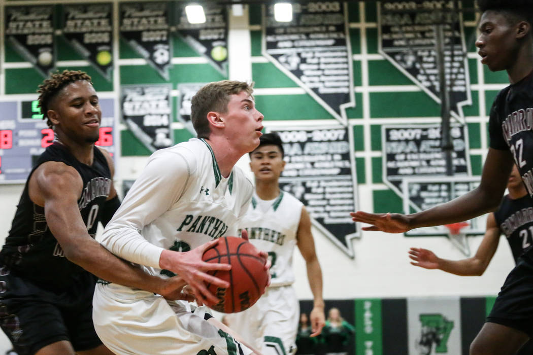 Palo Verde's Dane Clawson (20), second from left, is guarded by Cimarron-Memorial's Marcus Phillips (0), left, during the second quarter of a basketball game at Palo Verde High Schoo ...