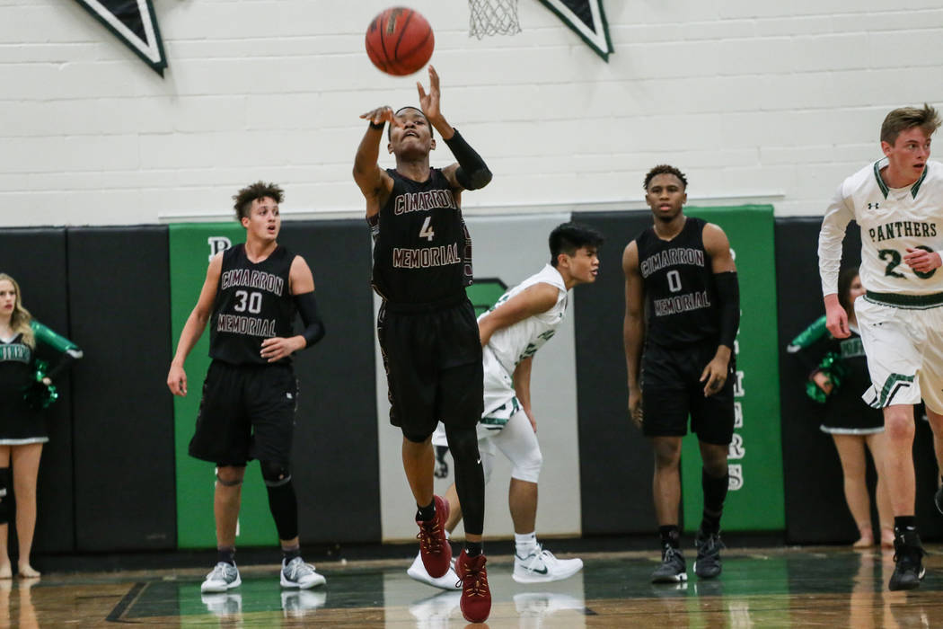 Cimarron-Memorial's Ricky Singleton (4) shoots the ball during the last seconds of the third quarter of a basketball game against Palo Verde at Palo Verde High School in Las Vegas, Thursday ...
