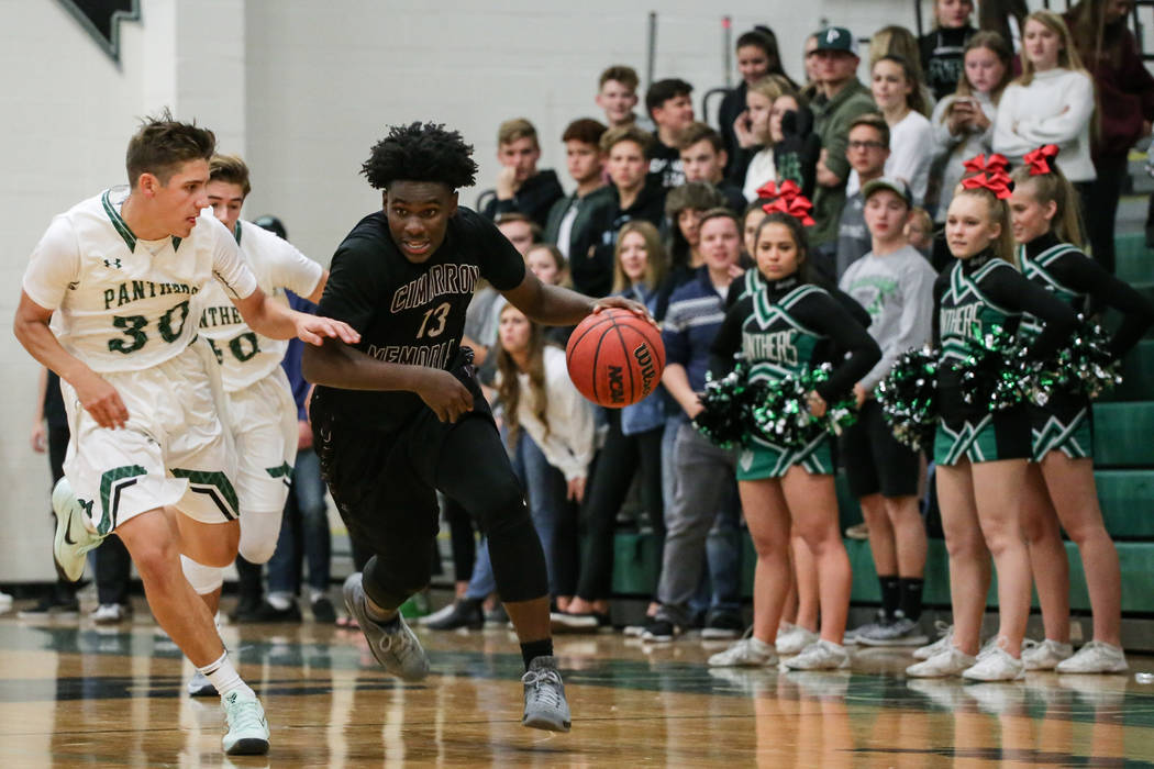 Palo Verde's Drew Warnick (30), left, guards Cimarron-Memorial's Brian Lang Jr. (13), right, as he dribbles the ball up court during the fourth quarter of a basketball game at Palo V ...