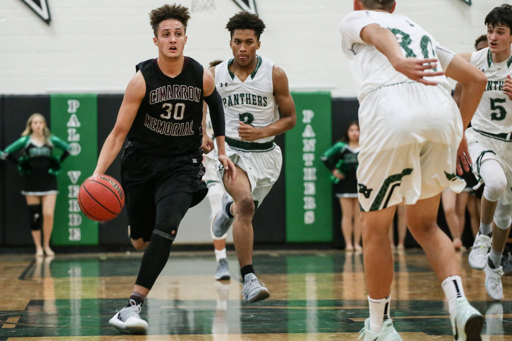 Cimarron-Memorial's George Tribble Jr. (30), left, dribbles the ball during the fourth quarter of a basketball game against Palo Verde at Palo Verde High School in Las Vegas, Thursday, Dec. ...