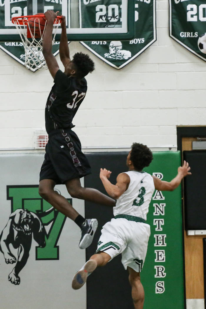 Cimarron-Memorial's Brian Washington (32) scores a slam dunk during the fourth quarter of a basketball game against Palo Verde at Palo Verde High School in Las Vegas, Thursday, Dec. 7, 2017 ...