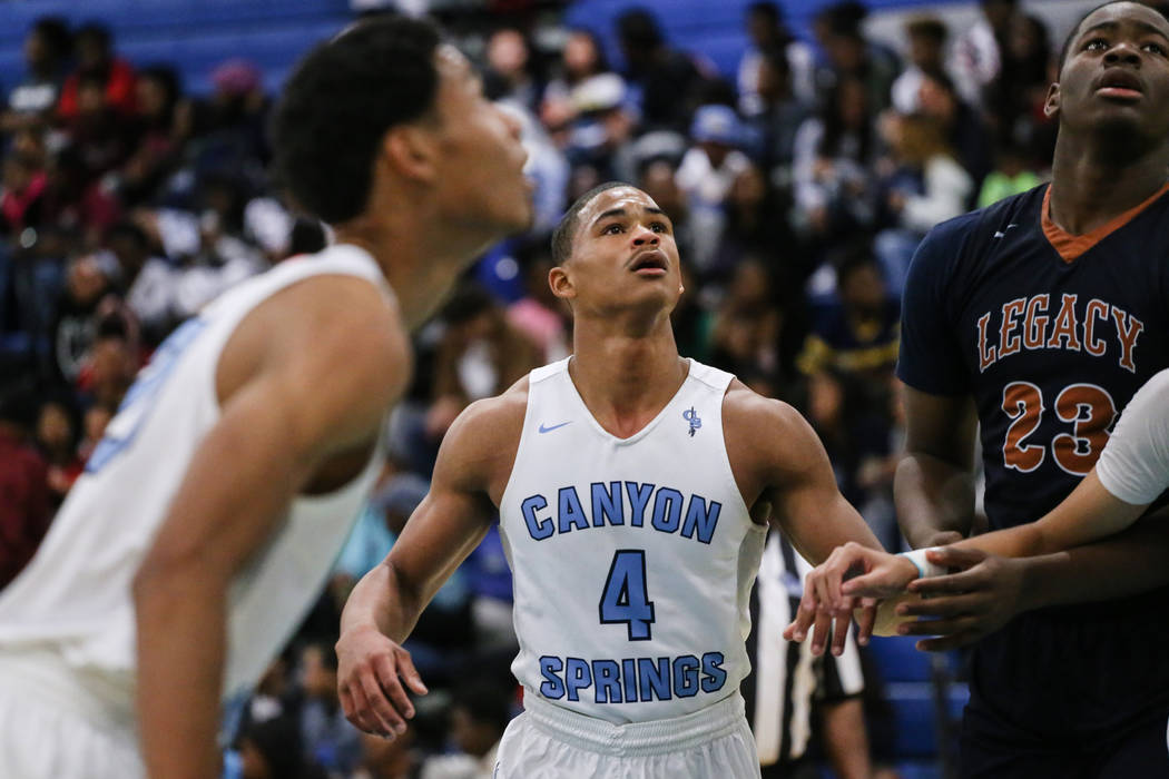 Canyon SpringsՠKevin Legardy (4), center, eyes the ball following a free-throw during the second quarter of a basketball game against Legacy at Canyon Springs High School in North Las Vegas, ...