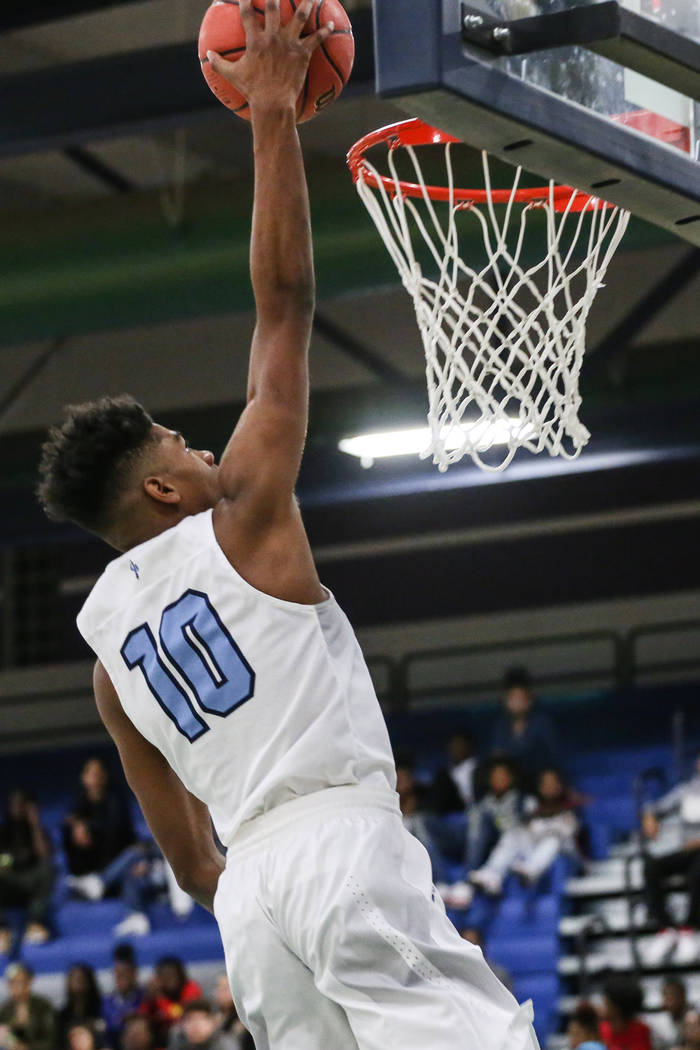 Canyon SpringsՠChristopher Ward (10) scores against Legacy during the fourth quarter of a basketball game at Canyon Springs High School in North Las Vegas, Friday, Dec. 8, 2017. Canyon Sprin ...