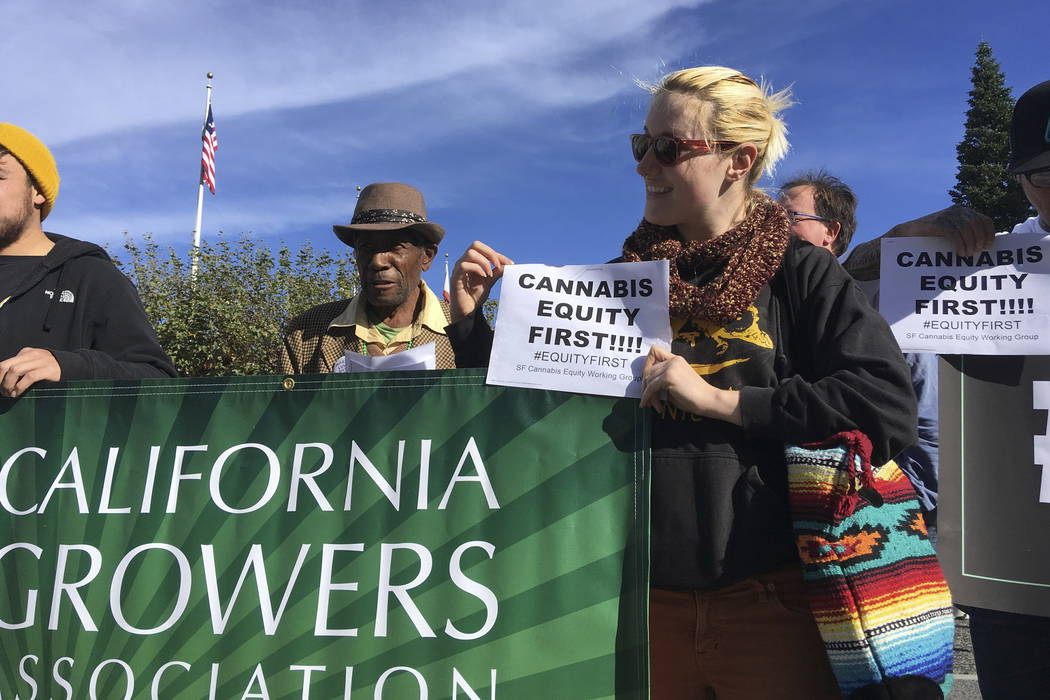 Cultivator Carla Selvin rallies outside City Hall to tout the benefits of marijuana and urge supervisors to pass pot-friendly regulations in San Francisco last month. (AP Photo/Janie Har)