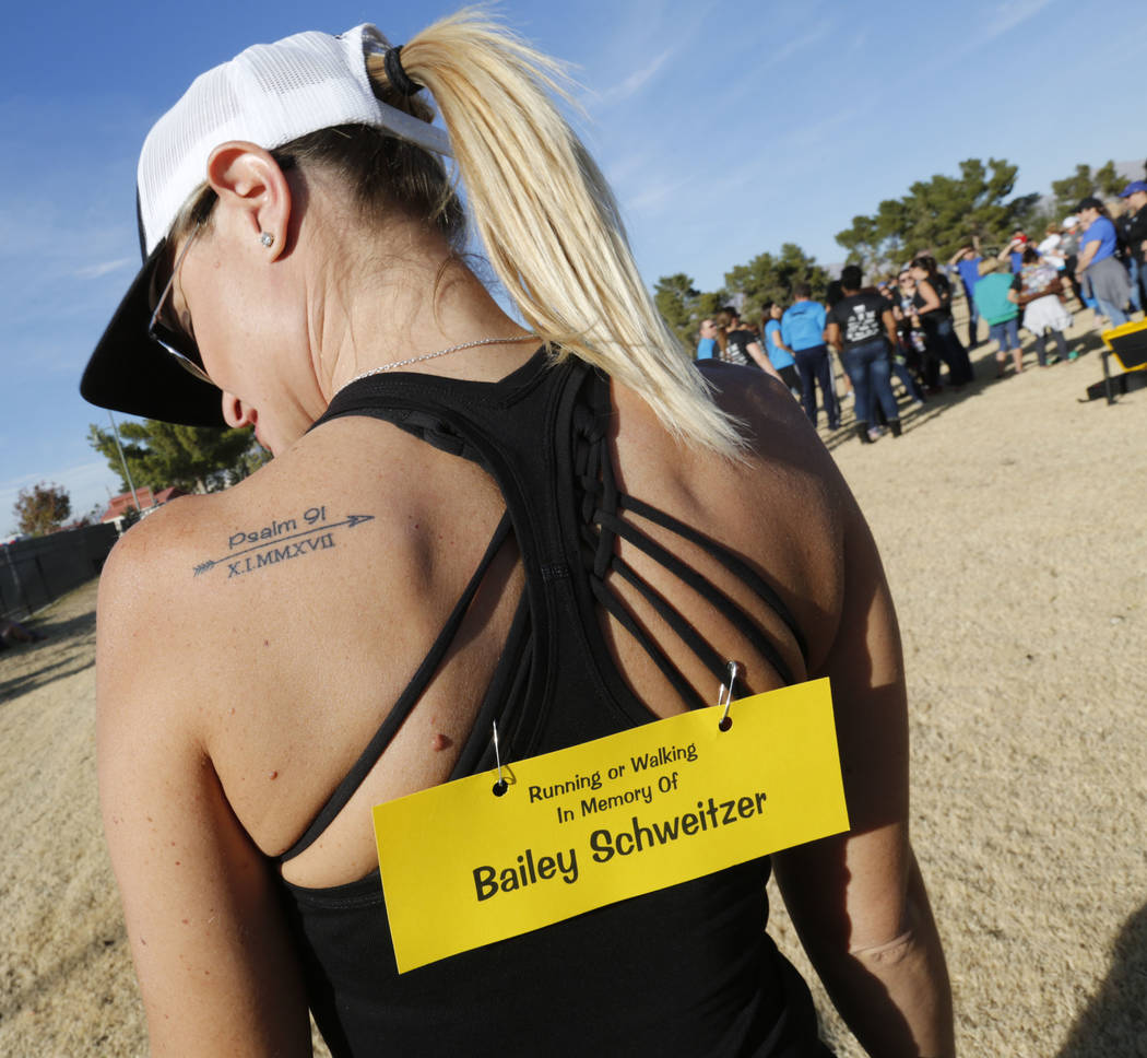 Christina Gruber, a Route 91 Harvest festival shooting survivor, shows her tattoo, Saturday, Dec. 2, 2017, before running the Vegas Strong 5K/1M at Craig Ranch Regional Park in North Las Vegas. Ch ...