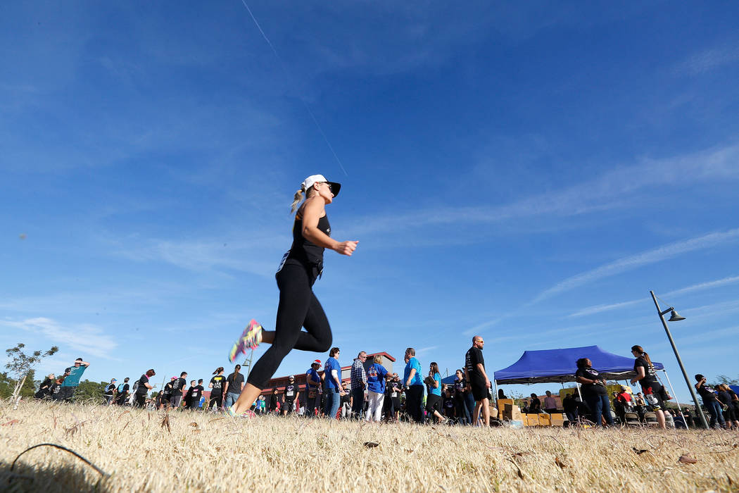 Christina Gruber, a Route 91 Harvest festival shooting survivor, warms up, Saturday, Dec. 2, 2017, before running the Vegas Strong 5K/1M at Craig Ranch Regional Park in North Las Vegas. Chitose Su ...