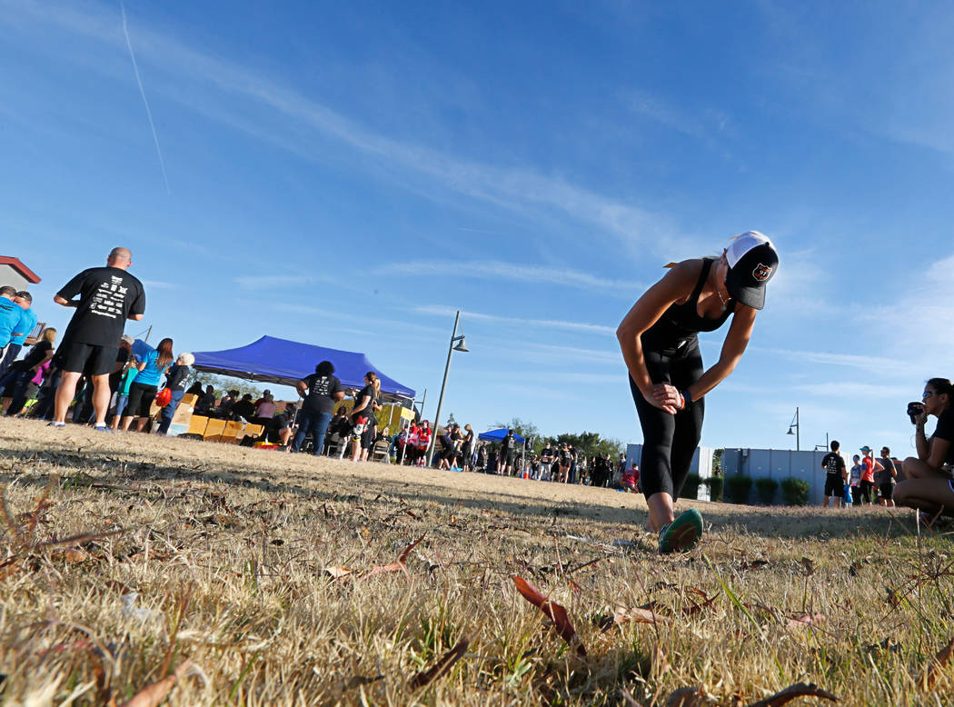 Christina Gruber, a Route 91 Harvest festival shooting survivor, stretches, Saturday, Dec. 2, 2017, before running the Vegas Strong 5K/1M at Craig Ranch Regional Park in North Las Vegas. Chitose S ...