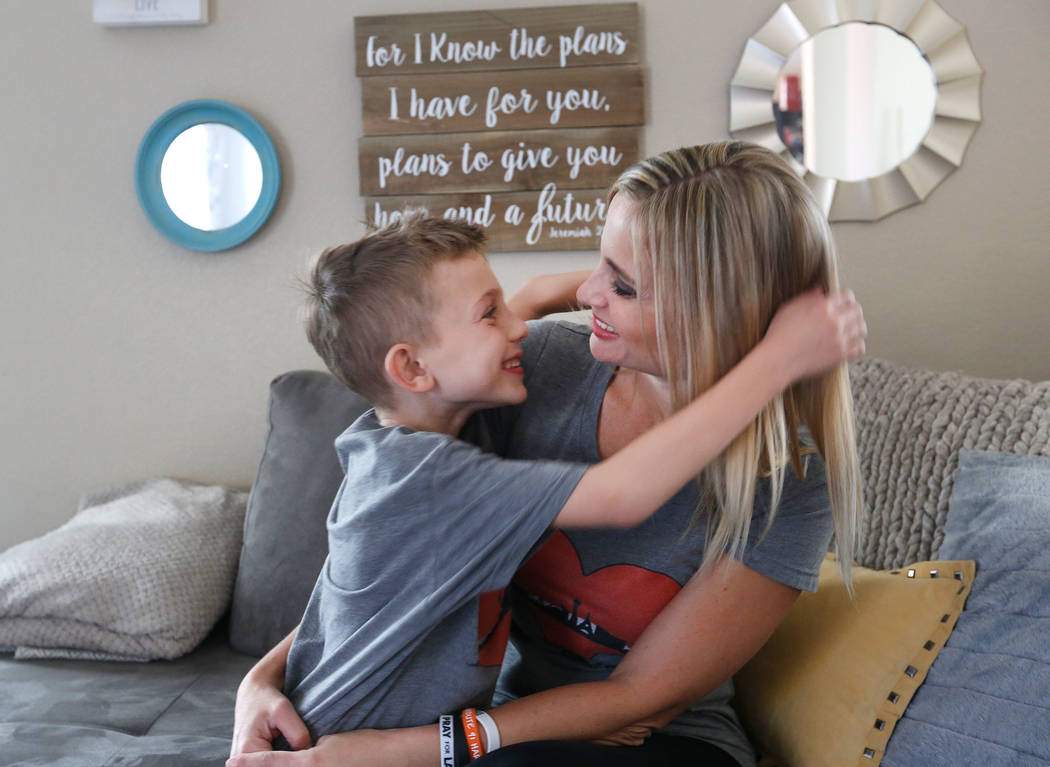 Christina Gruber, a Route 91 Harvest festival shooting survivor, and her son Jake, 7, in her home in Las Vegas, Saturday, Dec. 2, 2017, before going to run the Vegas Strong 5K/1M. Chitose Suzuki L ...